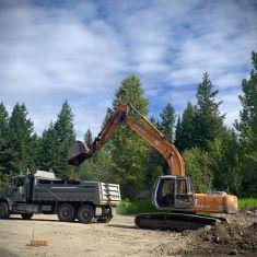 Excavator digging for footings